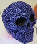 "<img src=Skull Gift.jpg"" alt=""Hand Made Skull Finished in Iridescent Paint With Screw, Nut and Bolt Design"">"