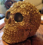 "<img src=Norfolk Crafts.jpg"" alt=""Skulls Finished in Antique Brass Featuring Exclusive Screw, Nut and Bolt Design"">"