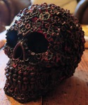 "<img src=SinisterSkull.jpg"" alt=""Skull Finished in Black and Red Featuring Exclusive Screw, Nut and Bolt Design"">"