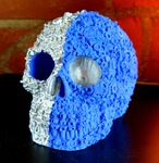 "<img src=Skull Metallic.jpg"" alt=""Skull Finished in Metallic Silver With Blue Paints Featuring Exclusive Screw, Nut and Bolt Design"">"