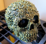 "<img src=Skull Metallic.jpg"" alt=""Skull Finished in Deep Olive Green With Gold Paints Featuring Exclusive Screw, Nut and Bolt Design"">"