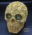 "<img src=Skull Gift.jpg"" alt=""Skull Ornament Finished in Metallic Gold Featuring Nut and Bolt Design"">"